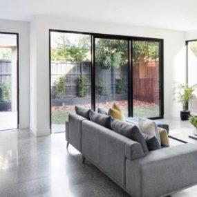 Interior polished concrete living room fireplace
